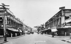 "Magallanes Street. An overview of Calle Alfonso XIII which had been renamed years ago in Magallanes Street, as pictured from corner Manalili Street in 1930's. Note numerous bazaars operated by Japanese and Chinese as well as the Cebuanos where one could buy clothes, shoes, sporting good and what have you at a minimal price. The ""parada"" or tartanilla in those years dominated the busy street. University of San Carlos Cebuano Studies Center Library, Northern Illinois University"