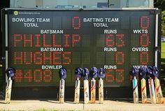 Cricket bats and caps belonging to the players are placed near the scoreboard which displays a tribute to Phillip Hughes during a match between Carlton and Fitzroy Doncaster grade at Princes Park Cricket Bat, Espn, Bowling, Sports News, Club, Australia, Bats, Legends, Jackson