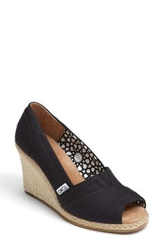 Free shipping and returns on TOMS 'Calypso' Canvas Wedge at Nordstrom.com. Woven trim accents the wrapped wedge heel of a summery open-toe pump fashioned from canvas with a soft leather footbed. <br><br>Since Blake Mycoskie started TOMS in 2006, the company has given away 10 million shoes to children in need across the globe through sales of their now-iconic shoes and their innovative 1-for-1 donation program.
