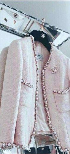 Pale pink embellished Chanel blazer.