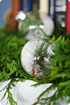 DIY snow ornament - the hint of greenery and snow within the ornament adds a hint of nature to your holiday cheer!