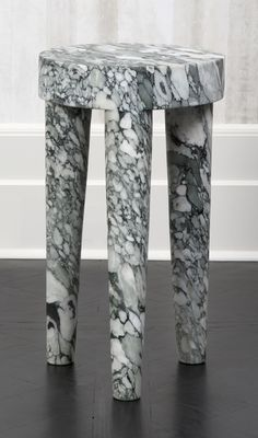 KELLY WEARSTLER | TALL TRIBUTE STOOL. Hand-sculpted out of a solid block of Big Flower marble.