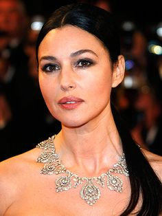 "Cannes' Most Dazzling Diamonds (and Rubies, and Emeralds) in the Past 10 Years | MONICA BELLUCCI, 2009 | ""The sultry Italian star turned heads at the Don't Look Back premiere. Her Cartier selections, including her diamond collar 'Tradition' necklace, added a regal touch to her her Dior dress."""