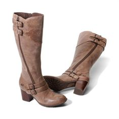 A dramatic zipper line and distinctive buckle straps create this military-inspired boot.  Selected by the editors of www.runningwithheels.com