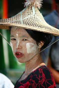 Woman with sedge hat and thanaka make up, Myanmar   © Eric L…   Flickr
