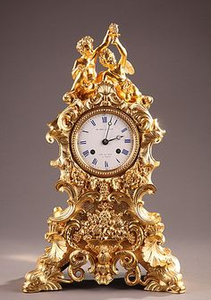 A French ormolu clock in rococo style ornate. This clock is very curvy and covered in gold detailing. Its so bold and lavish it just has to be from the Rococo period. Mantel Clocks, Old Clocks, Clock Decor, Vintage Clocks, French Rococo, Rococo Style, Clock Antique, French Clock, Grandfather Clock