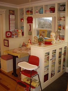 I love the idea of a banquette backed with glass cabinets - reminds me of my grandparents bungalow