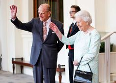 THE ROYAL WAVE:   Queen Elizabeth and Prince Philip show off the royal wave they've spent 60-plus years perfecting as they continue their state visit with the King and Queen of Spain in London on Friday.