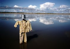 Alex Webb Alberta. A scarecrow left in tailings ponds to protect birds from noxious substances - 2005.