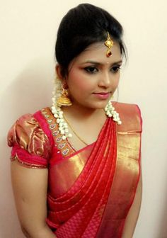Traditional Southern Indian bride wearing bridal silk saree and jewellery. Engagement look. Makeup and hairstyle by Swank Studio. #BridalSareeBlouse #SariBlouseDesign Find us at https://www.facebook.com/SwankStudioBangalore