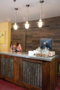 barn yard wood, galvanized metal counter, pendant lights, sales counter, recycled wood counter