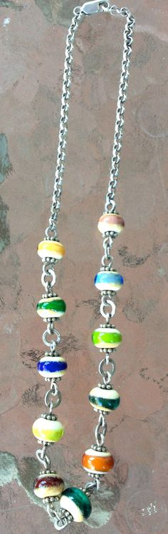 CYBER MONDAY SALE! Handmade glass beads on a sterling silver chain. Etsy.com/enamelartbyleslie #handmadebeads #handmadenecklace #beadednecklace #sterlingsilvernecklace #colorfulnecklace #colorfulbeads