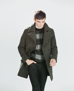 The dark colors blend so well that it's hard to tell that the double breasted peacoat is khaki green.  From Zara's 2014 Fall/Winter lookbook.