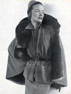 Model in wool jersey ensemble with fur lined cape by Robert Piguet, photo by Arik Nepo, 1949
