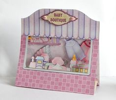 3D BABY GIRL SHOP pop up window card kit on Craftsuprint designed by Janet Briggs - made by Denise Murray - Printed onto 220gsm matte photo paper,cut out all the elements and made up following the very clear instructions.I used glue gel when adding my decoupage and finished with two pink buttons.A super cute and dimensional design that folds flat and comes with a matching envelope...perfect for any new arrival - Now available for download!