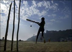 Children play cricket on the banks of the River Tawi in Jammu, Indian-administered Kashmir.