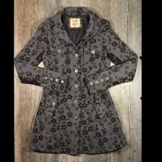 Free People floral wool long coat Free People floral wool long coat. 32 inches long. Fair amount of piling, see pic for example, can be removed with care. Polyester wool blend. Tag reads size 0. Free People Jackets & Coats