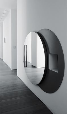 Zaetta Studio Architecture | hidden laundry chute inside a residence in Treviso, Italy