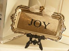Vintage silver tray with holiday words on an easel...so cute.