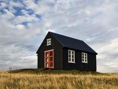 black house white windows orange doors