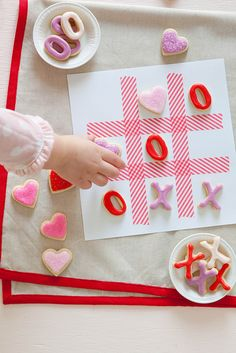 XOXO Tic tac toe cookies. Fun idea as is for Valentine's Day, or change cookie shapes and royal icing colors for Christmas, Thanksgiving, St. Paddy's Day, Easter or patriotic holiday celebrations.