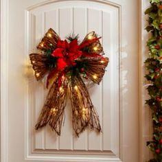 Decorate your door with the Pre-Lit Red Poinsettia Rattan Bow. #kirklands #holidaydecor #KirklandsHoliday