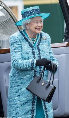 The Monarch wore a turquoise wool crepe dress and turquoise tweed coat by Karl Ludwig and a matching hat with a lace trim by Angela Kelly