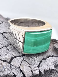 A personal favorite from my Etsy shop https://www.etsy.com/listing/521588348/mens-silver-ringmens-malachite-ringsize