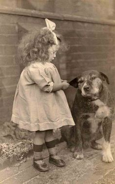 Through the years, some things never change... like the patience that dogs can show towards the children they love.