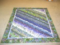 """Nancy's S/T quilt. """"Quick Quarter Quilt"""" by Eleanor Burns from """"Quick Trip Quilts"""" book. Blue/green batiks for beach theme guest bedroom, of granddaughter Stephanie and husband Travis."""