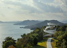 The stunning building in a stunning setting overlooking the Hiroshima coastline is a powerful symbol of two lives intertwined and joined in matrimony. Description from jasonleesdesign.com. I searched for this on bing.com/images