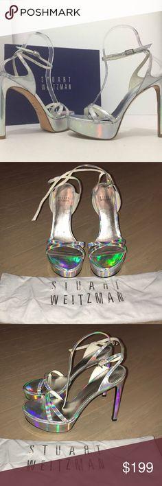 Stuart Weitzman Bebare Platform Sandal Silver Twice worn. Silver metallic platform sandal. Picks up rainbow glare with light. Small Black scuff marks on front of platforms. Otherwise great condition. Stuart Weitzman Shoes Heels