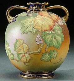 A NIPPON CORALENE DECORATED HANDLED VASE circa 1909 WITH BEADED GLASS DECORATION OF AUTUMN GRAPES ON A GREEN AND AMBER SATIN GROUND AND COBALT BLUE TRIM