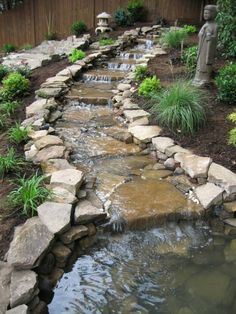 Outdoor Waterfall by Autumn View Landscape & Design Co.