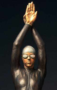 #Bronze Swimmers Water Polo Divers Diving sculpture #sculpture by #sculptor Deon Duncan titled: 'The Triathlete (bronze female Athlete in Wetsuit statue)'. #art #artist #artwork #DeonDuncan