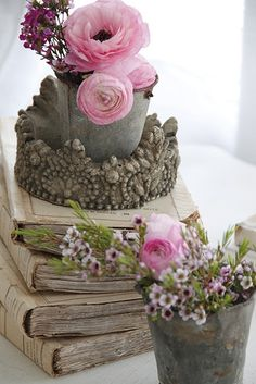 Books, metal pails with pretty pink flowers........sweet