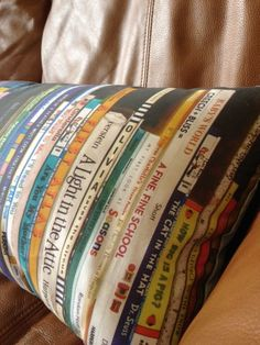 This is SOOO cool!  Its a photo of favorite childhood books taken from a ladys bookshelf, she printed it onto fabric  made into a pillow!  Really need to learn how to sew so I can make one too :)