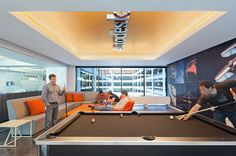 Autodesk SF - The glowing orange Autodesk game room ceiling is visible across the floor and flanks One Market Plaza atriums, broadcasting Autodesk's presence in the building. Gensler: Workplace Interior Design