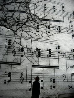 On the side of a building- so you think there is a musician in the room across the road?