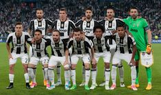 Juventus FC team line up before the UEFA Champions League Quarter Final first leg match between Juventus and FC Barcelona at Juventus Stadium on April 11, 2017 in Turin, Italy.