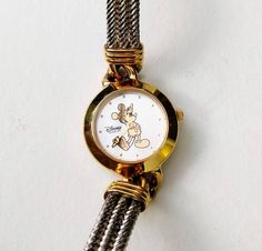 Mickey Mouse Watch for women, Walt Disney watch for ladies watch, Womens watch, Small watch, Montre femme, Gold ladies watches for women **** THE STORY **** Nothing lasts forever. But some things are timeless, and we can return to them time and time again and find the memories that Mickey Mouse Watch, Ladies Watches, Pocket Watch, Walt Disney, Memories, Trending Outfits, Unique Jewelry, Handmade Gifts, Lady