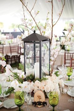 Lantern Centerpieces and earth tones create a natural, outdoorsy vibe with elegance