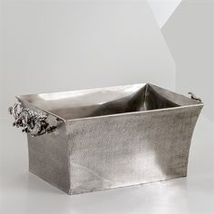 The Natori Party Bucket with Dragon Handles is an elegant decorative piece with functionality. Made from brass, this silver party bucket is perfect for dinner parties.