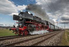 "Former Deutsche Bundesbahn express train steamlocomotive 01 202 (4-6-2) of association ""Pacific 01 202"" in Lyss, is accelerating her train t..."