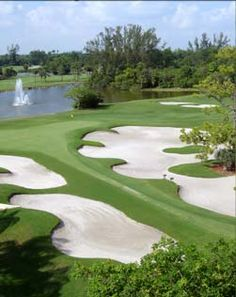 BOCA RIO GOLF CLUB: The 18-hole private golf course opened in 1966 measures 7116 yards from the longest tees. Designed by Robert von Hagge with a par-72 layout sure to challenge even the most seasoned golfer. (Boca Raton, Florida). Picture Yourself in Paradise at www.floridanest.com