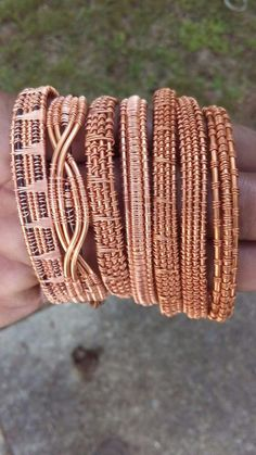 This is an excellent study in different wraps with the final result being a full bangle set. I would consider adding beads for a pop of color. #wirejewelry