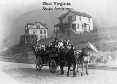 Gary, West Virginia, circa 1917, two-horse-drawn wagon carrying children to school.