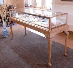 Custom designed jewelry display case with ball and claw legs at custom.display-smart.com
