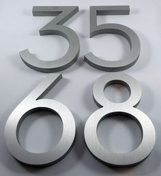 Bold modern house numbers in brushed aluminum Door Numbers, House Numbers, House Letters, Porch Furniture, Furniture Layout, Exterior Signage, Diy Shutters, Small Modern Home, Metal Homes