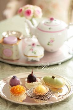 These mini pastries look good. The tea set in the back is so cute